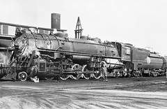 Atlantic Coast Line 2-10-2 Santa Fe, Class Q-1, Steam Locomotive # 2018, seen in a railroad yard, possibly Acca Yard in Richmond (alcomike43) Tags: old railroad blackandwhite bw classic yard train vintage photo tracks engine historic photograph locomotive engineer acl steamengine rightofway steamlocomotive 2018 q1 acca railroadyard hogger atlanticcoastline vanderbilttender auxillarywatertender