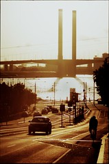 hellscape with bridge (mugley) Tags: road city bridge urban orange sun black cars film water bike architecture river cityscape glare fuji cyclist minolta silhouettes engineering australia melbourne slide victoria scan chrome transparency yarra epson pointandshoot docklands konica positive pylons e6 streetscape urbanlandscape sensia victoriaharbour boltebridge tramtracks citylink warmtones sensia100 nearsunset latrobest v700 hellscape fujisensiaii100ra freedomzoom160 rivazoom160 minoltafreedomzoom160