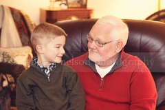 (Rebecca812) Tags: christmas family boy red portrait man green love home smile beard happy glasses togetherness sweater chair sitting child joy grandfather pride grandpa lap grandson tradition generation bonding whitehair generationgap lookingateachother canon5dmarkii rebecca812 heritage2011