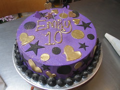 Wicked Chocolate cake iced in purple butter icing decorated with piped gold message & black & gold fondant hearts, stars & polka dots (Charly's Bakery) Tags: birthday cake town tv chocolate wicked angels bakery reality cape teenage affordable charlys january2010