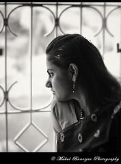 Girl by the Window (BW) (Mukul Banerjee (www.mukulbanerjee.com)) Tags: shadow portrait blackandwhite woman inspiration girl beautiful beauty closeup portraits 35mm photography eyes nikon women tanya bokeh pics head sister candid gorgeous delhi indian style images photographs dslr tania newdelhi closer bengali d300 maumita bymukulbanerjee mukulbanerjee mukulbanerjeephotography mukulbanerjeephotography wwwmukulbanerjeecom wwwmukulbanerjeecom