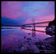 Tacoma Narrows DRI Vertorama (Bryan Koorstad) Tags: bridge pink blue sea sky usa art water beautiful architecture clouds sunrise canon square lens landscape photography rebel photo interesting scenery rocks pretty purple dynamic angle wide magenta sigma bryan squareformat format tacoma manual 1020mm range dri increase narrows blending 550d t2i vertorama koorstad