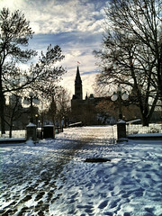 Peace Tower in the snow (Dani_Girl) Tags: trees winter shadow sky snow clouds contrast path dailypic bare ottawa silhouettes footprints peacetower parliamentbuildings iphone iphoneography gettyimagescanada gettymobilesubmit
