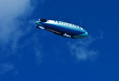 The DirecTV HD Starship (praline3001) Tags: blue sky sports clouds canon photography photo football louisiana neworleans alabama lsu helium frenchquarter blimp airship crimsontide superdome directtv niftyfifty canon50mmf14usm lightshipgroup canonrebelt3i