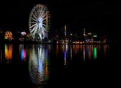 Hyde Park Fair (Jonathan_Grundy) Tags: lake reflection london water night dark lights hydepark bigwheel serpentine fairgroud