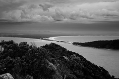 A view over Tomaree National Park  from Tomaree Head, Port Stephens (Nomad Boff) Tags: ocean travel sea blackandwhite tree beach clouds canon landscape mono australia backpacker portstephens eastcoast canonxs 1000d