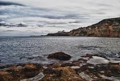 Simplemente... mirando (juanlux17) Tags: mar agua nikon paisaje mm nikkor 18 55 rocas melilla manfrotto tripode d3000 flickrstruereflection2
