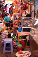 Cambodia man caught (mediaexpression.nl) Tags: alley cambodia southeastasia khmer market nails phnompenh manicure pedicure kampuchea canoneos40d ivoposthumus wwwmediaexpressionnl mediaexpression