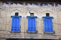 Three Blue Windows (Saumil U. Shah) Tags: world travel blue wallpaper vacation india house holiday color colour building art tourism window monument colors painting mural colorful asia colours indian indigo tourist mansion colourful traveling fresco rai rajasthan shah haveli trekker mandawa gulab  saumil jhunjhunu  shekhawati incredibleindia  ladia worldtrekker saumilshah   gulabrailadia