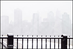 At Manhattan (Linus Gelber) Tags: city nyc winter snow newyork weather skyline fence manhattan snowstorm brooklynheights brooklynheightspromenade pale faded promenade eastriver newyorkskyline thursdaywalk canon28135mmisusm utata:project=tw300