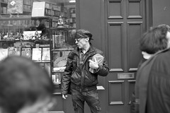 Mystery man on a mission... (hethelred) Tags: street leica man black london hat sunglasses leather 35mm f14 voigtlander cap mysterious reverse m9