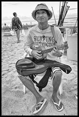 Ukuklele Playing Surf Instructor (Scott Sharick) Tags: portrait people bw musician male beach hawaii blackwhite sand surf ukulele oahu waikikibeach instructor