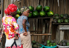 Watermelon Ladies (cowyeow) Tags: poverty africa street ladies cute fruit lady stand women funny village african traditional poor watermelon uganda fruitstand seller funnysign kasese africanwomen funnyafrica