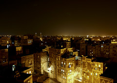 Night View Of Storeyed Tower Houses Built Of Rammed Earth, Sanaa, Yemen (Eric Lafforgue Photography) Tags: city light house building history horizontal architecture night buildings dark stars outside construction asia nightshot outdoor empty minaret middleeast nobody nopeople mosque calm architectural unescoworldheritagesite unesco worldheritagesite arabia housing historical yemen nightview preserved copyspace sanaa residence technique functional oldcity sana preservation worldheritage craftsmanship colorphoto darksky colorpicture placeofinterest arabiafelix arabianpeninsula worldheritagecity thickwall colourpicture vernacularhouse capitalofyemen localmaterial buildingskill flatearthroof blissfularabia harmoniousarchitecture