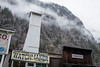 Three Valley Gap (flippers) Tags: ca old cloud mountain canada tower heritage sign fog clouds vintage haze cowboy bc britishcolumbia retro ghosttown watchmaker lowlying threevalleygap 3valleygap columbiashuswape