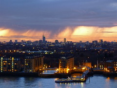 London at Dusk with Rain (Deepgreen2009) Tags: city light sunset orange london rain weather skyline clouds shower dusk wharf canary brief