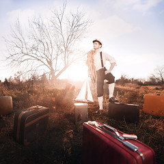 The Sailor's Dream (Rob Woodcox) Tags: road light sunset sea sky tree colors fashion dream surreal trunk imagination sailor suitcase goldenhour robwoodcox robwoodcoxphotography