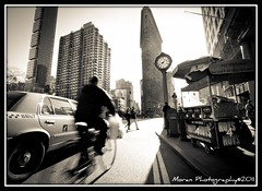 The Pulse of NYC (EASY GOER) Tags: life street nyc newyorkcity light sun clock buildings photography skyscrapers manhattan citylife landmarks 5thavenue streetlife alive flatironbuilding bigcity
