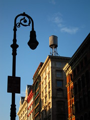 Lampost and buildings SOHO (foto5) Tags: nyc morning ny newyork brick tower lamp silhouette architecture canon buildings day soho watertower bluesky historic lampost s90