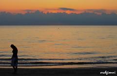 alba a rimini 2 (archgionni) Tags: sea italy orange beach water lady clouds sunrise sand italia nuvole mare waves peace alba sunsets run pace sunrises storms acqua spiaggia arancione onde sabbia signora passeggiare