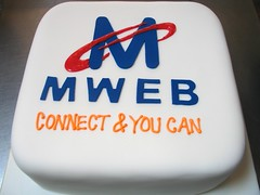 Square Wicked Chocolate cake covered in white fondant decorated with MWEB logo (Charly's Bakery) Tags: cake corporate tv chocolate wicked angels bakery reality charlies charleys charlys october2010