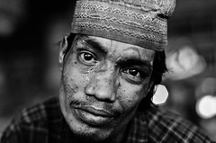 Stranger [86/100]: Tears of agony (A. adnan) Tags: poverty street portrait people blackandwhite bw man monochrome night project eyes nikon eyecontact dof sad bokeh availablelight f14 poor crying strangers documentary beggar strong tear bangladesh handicapped gec chittagong nikkor50mmf14d nikon50mmf14d bangladeshiphotographer 100strangers d7000 peopleofbangladesh aadnan613 gettyimagesbangladeshq3 geccirclechittagong gecmoore