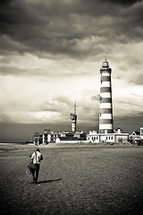 Walker (Coussier) Tags: winter people bw lighthouse guy praia beach portugal buildings europe village farol casas barra aveiro aldeia ilustrarportugal