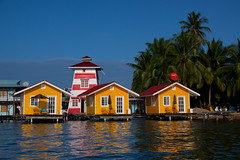 New Bocas Hotel: El Faro del Colibri Hotel on Isla Carenero - Bocas del Toro, Panama (ChrisGoldNY) Tags: travel sea lighthouse reflection latinamerica water yellow architecture reflections lighthouses day forsale stripes clear palmtrees viajes posters tropical caribbean hotels panama bocasdeltoro bookcovers centralamerica albumcovers caribe gridskipper bocas hotelchatter jaunted islacarenero thechallengefactory regionwide chrisgoldny chrisgoldberg elfarodelcolibri newyorktimesthe45placestogoin2012 chrisgold chrisgoldphotos