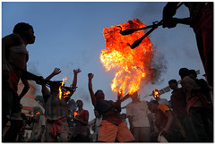 fireplay - 3 (Soumya Bandyopadhyay) Tags: red people festival fire low wide perspective ritual splash throw westbengal gajon canon1785mmis charak canoneos40d