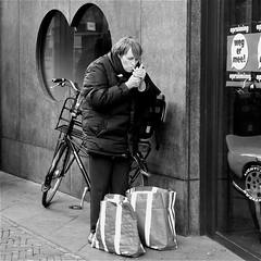 Smoke (Akbar Simonse) Tags: street people urban bw woman holland netherlands monochrome bicycle shopping square zwartwit cigarette candid streetphotography denhaag smoking bags thehague vrouw fiets streetshot straat roken opruiming batavus straatfotografie straatfoto wegermee boodschappentassen straatfotograaf dedoka akbarsimonse