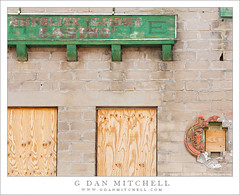 Rhyollite Ghost Casino (G Dan Mitchell) Tags: park railroad travel red orange usa detail building brick green abandoned window up station sign wall america print death town desert nevada ghost north stock scenic railway casino structure national valley license weathered block rhyolite plywood boarded cinder