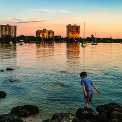 ready to jump into rainbow colored waters (laughlinc) Tags: city boy sunset reflection water skyline square boat rainbow child gulf florida 4 beta sarasota photooftheweek lightroom 1755mmf28 lr4 nikond80 thechallengefactory sarasotamagazine lightroom4beta