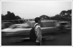 Passer by (Abhirup Bose) Tags: red blackandwhite bw yellow travellers streetphotography digitaldarkroom eliteclub flickraward creativephotogroup grouptripod flickrtravelaward groupwithexperience kuwaitphotographyclub