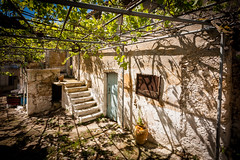 Courtyard (Victor van Dijk (Thanks for 3.8M views!)) Tags: door shadow favorite window leaves stairs canon greek decay courtyard fave greece shade grapes zante zakynthos faved binnenplaats victormk1 wwwvictorvandijkcom