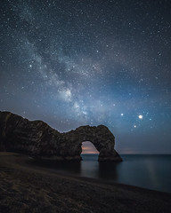 Milky way over Durdle Door (chasingthe_stars) Tags: ocean longexposure nightphotography blue sea sky mars cliff seascape reflection beach beautiful rock night canon dark stars landscape coast sand arch shingle astro nighttime galaxy shore astrophotography dorset limestone coastline nightsky saturn archway constellation purbeck lulworth darksky stargazing milkyway rockformation geological durdledoor antares jurassiccoast beautyinnature samyang lulworthestate canon6d samyang14mmf28