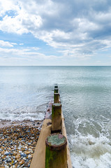 Dead calm (D1g1tal Eye) Tags: sea sky cloud beach coast nikon horizon wave groyne tamron1750mmf28 d7000