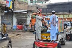 Two Men Enjoying A Van Ride in Malakand (Emaad Paracha) Tags: festival fort top pass mosque valley mir dir kalash shahi mardan chitral malakand lowaripass lowari terich bumburet lowaritop timergara chilimjusht