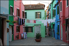Burano Island,  Venice, Italy (SunyFLx4) Tags: travel venice italy island colorful europe bright lace courtyard neighborhood laundry clotheslines burano lacemaking venetianlagoon