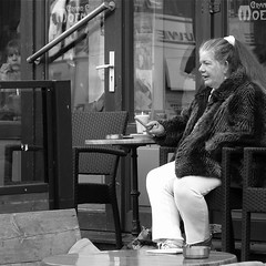 Coffee and a Cigar (Akbar Simonse) Tags: street people urban bw woman holland netherlands coffee monochrome nijmegen zwartwit candid streetphotography cigar smoking smoker streetshot straat straatfotografie straatfoto straatfotograaf dedoka nederlandvandaag akbarsimonse