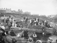Ladies' Bathing Place (National Library of Ireland on The Commons) Tags: men fashion swimming women rocks cove hats 1900 northernireland ulster portrush 1900s antrim brollies robertfrench williamlawrence nationallibraryofireland ladiesbathingplace lawrencecollection