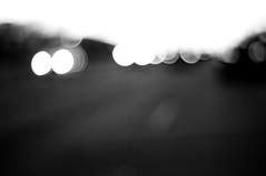 // (preteentitans) Tags: blackandwhite bw cars 50mm pentax bokeh blurred f2 lightroom3