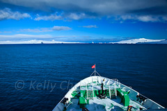 Antarctica-111122-033 (Kelly Cheng) Tags: travel blue sea white mountain snow color colour tourism nature water sunshine clouds landscape island daylight colorful day ship cloudy outdoor transport vivid sunny antarctica bluesky nobody nopeople colourful copyspace seacape traveldestinations