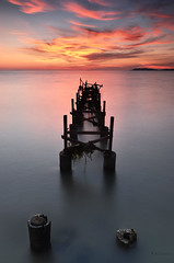 the remains IV Sunset (sirman88) Tags: longexposure sunset seascape motion port outdoors photography pier interestingness nikon dusk jetty malaysia bluehour dickson pantai 2012 calmness portdickson pasirpanjang revisited traveldestinations colorimage fishermanvillage negerisembilan d7000 tokina1116 azmanrahman sirman88