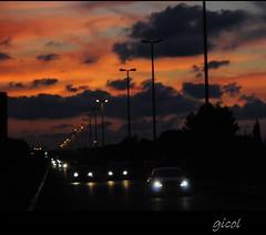 back home (#2) (gicol) Tags: road sunset sky italy car evening automobile strada tramonto colore afternoon via amanecer coche cielo commute headlight puglia bari tarde sera traffico fari apulia torreamare pomeriggio ss16 pendolare stradastatale16