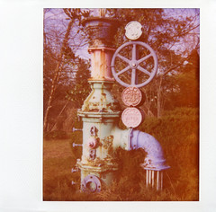 Colorful Rusty Pipe Sculpture; Long Island, New York (hogophotoNY) Tags: park camera original sculpture usa film water colors circle polaroid se rust unitedstates pipe rusty faded frame instant fade filmcamera spectra instantcamera expiredfilm filmphotography instantfilm softtone localpark polaroidfilm expiredpolaroidfilm hogo spectrase polaroidspectrase hogophoto instantfilmphotography polaroidsofttonefilm colorfulrustypipesculpture originalpolaroidsofttonefilm