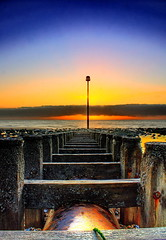 Graduation (Phil-Clements) Tags: pink blue sea sun tower beach sunrise dawn golden pipe pole eastbourne wish groyne hdr outfall photomatix