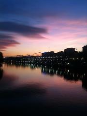 Ieri pomeriggio a Torino... (Raffaello Lamonaca) Tags: pink blue sunset sky black reflection silhouette clouds river landscape torino tramonto nuvole fiume rosa cielo po turin azzurro nero paesaggio riflesso iphone3gs