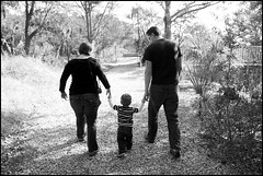 Heading Into A New Season in Life (greenthumb_38) Tags: family mom dad son husband wife offspring hands holdinghands walking together duotone bw blackwhite blackandwhite canon40d 1740mm southcarolina parrisisland path trail tree trees hike goingaway jeffreybass
