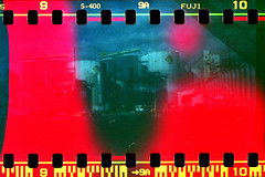 Tanked (Beaulawrence) Tags: light canada color colour fall classic industry vancouver analog 35mm vintage lens toy fantastic lomo lomography october industrial fuji bc accident superia flash transport grain large columbia scan retro gas east full plastic negative diana f 400 frame oil british asa 135 van leak ports remake reproduction fuel tanks chemical sprockets 2011 sooc