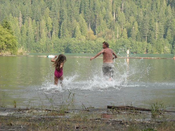 papa & tatum running in the water
